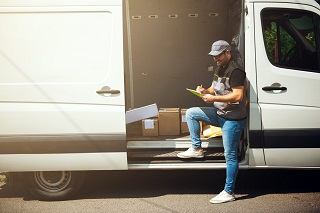 Man checking van delivery